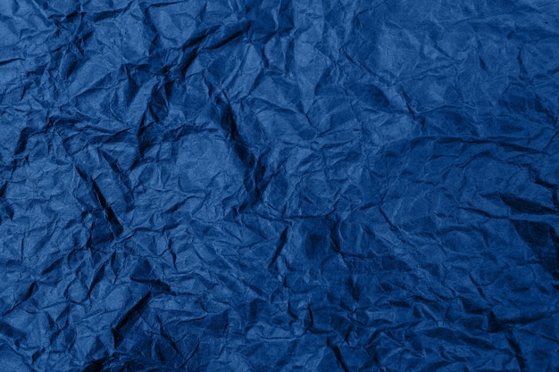 High detailed abstract crumpled packaging paper texture background. in blue color.