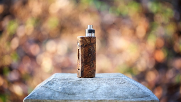 High end natural stabilized wood box mods with rebuildable dripping atomizer