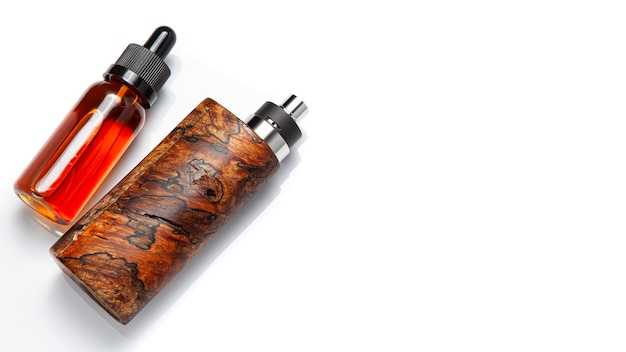 High end rebuildable dripping atomizer with stabilized natural spalted wood regulated box mods and e-liquid bottle