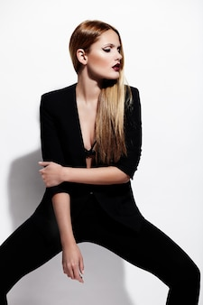 High fashion look.glamor portrait of beautiful sexy stylish caucasian young woman model in black cloth with bright makeup