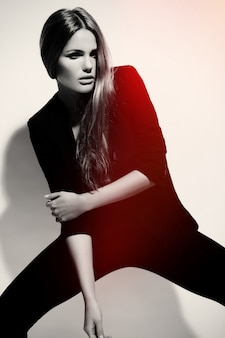 High fashion look.glamor portrait of beautiful sexy stylish caucasian young woman model in black cloth