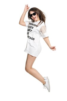 High fashion look.glamor stylish beautiful young woman model in summer bright white hipster cloth jump