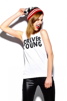 High fashion look.glamor stylish beautiful  young woman model with red lips  in hipster cloth in colorful beanie