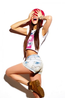 High fashion look.glamor stylish beautiful  young woman model with red lips  in summer bright colorful  hipster cloth