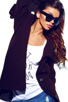 High fashion look.glamor stylish sexy beautiful  young brunette woman model  in summer bright  hipster cloth in glasses in coat