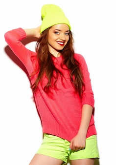 High fashion look.glamor stylish sexy beautiful young brunette woman model in summer bright hipster cloth in yellow beanie