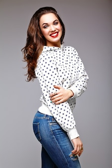 High fashion look.glamor stylish sexy smiling beautiful young woman model in summer bright jeans  hipster cloth