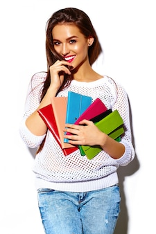 High fashion look.glamor stylish sexy smiling beautiful young woman model in summer bright white casual  hipster cloth with colorful clutch  purse