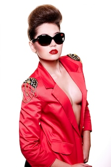High fashion look. glamour close-up portrait of sexy brunette caucasian young female woman with bright make-up with red lips in bright pink jacket in sun glasses
