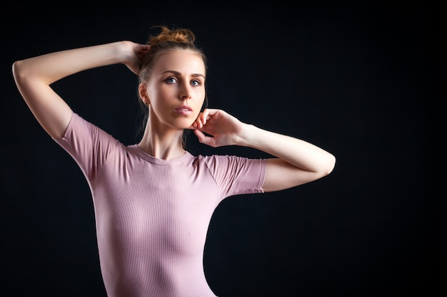 High fashion portrait of young elegant woman on beige top.
