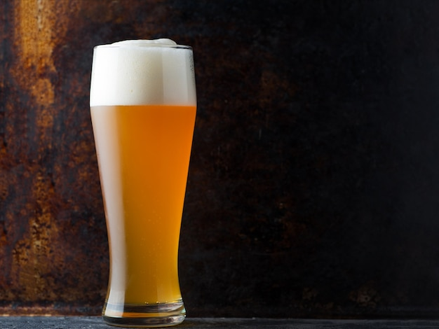 High glass of wheat foam beer copy space