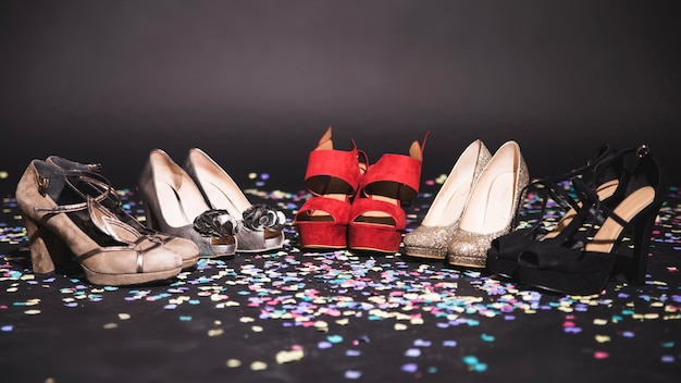 High heels on the floor with confetti