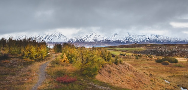 High icelandic or scottish mountain landscape with high peaks and dramatic colors