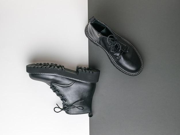 흑백에 높은 가죽 부츠. 거친 세련된 신발.