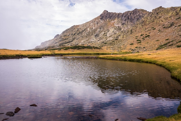 High mountain lake protected by its special flora