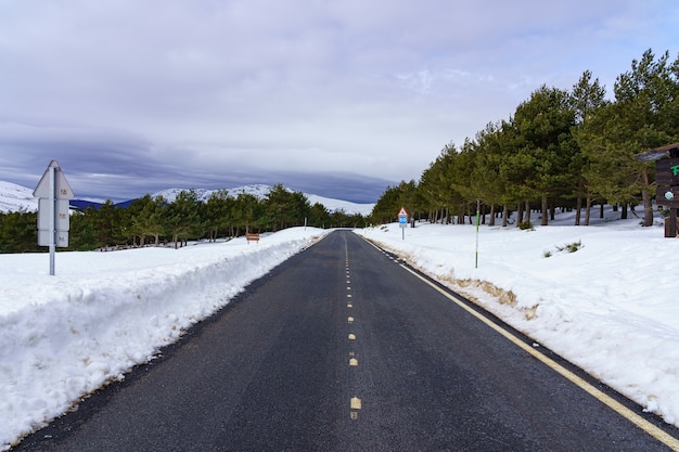 High mountain road with clouds and blue sky. morcuera madrid. spain.