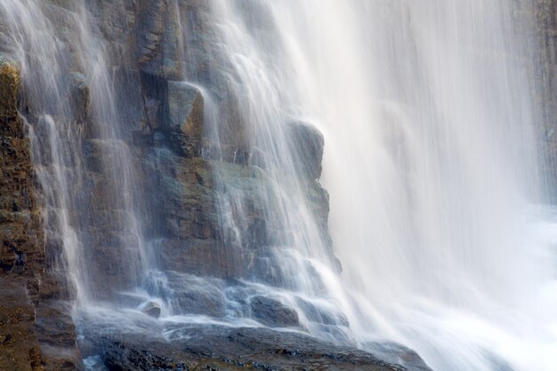 High mountain waterfall in dark wild carpathian forest  (long exposure shooting)