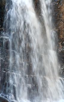 High mountain waterfall in dark wild carpathian forest