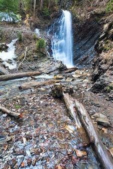 High mountain waterfall in wild carpathian forest (guk waterfall, ivano-frankivsk region,  ukraine).