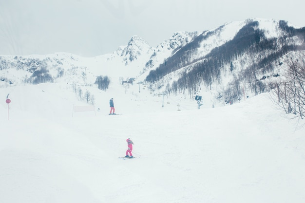 High mountains under snow in the winter. ski resort. skiers descend from the mountain
