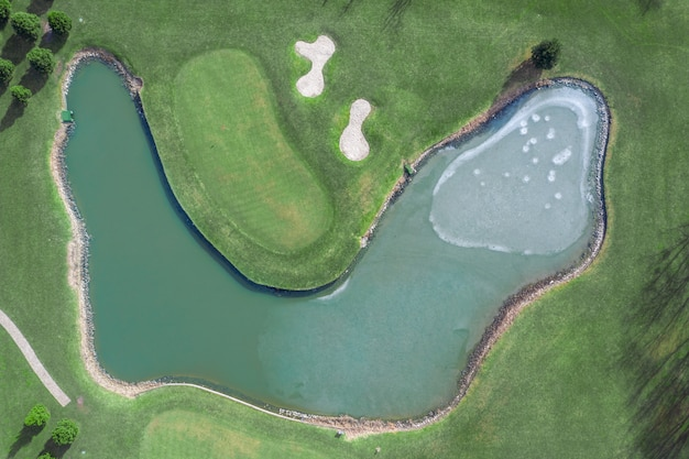 High quality golf courses with lakes in mezhigorye national park. green grass, small blue lakes.