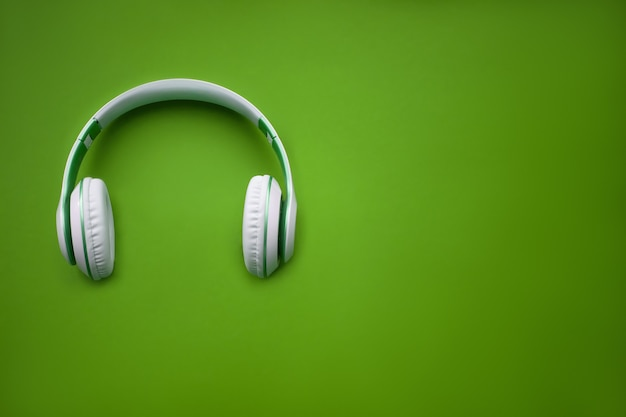 High-quality headphones on a green background. music concept.