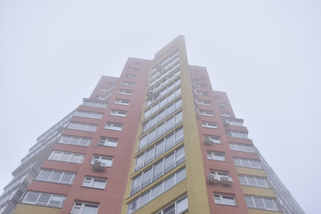 High-rise apartment building in the fog