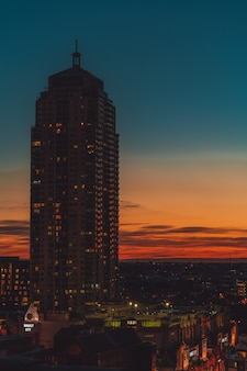 High rise building with an orange and blue sky