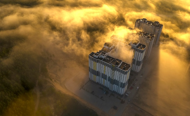 High-rise skyscrapers, sunlight and morning fog. aerial