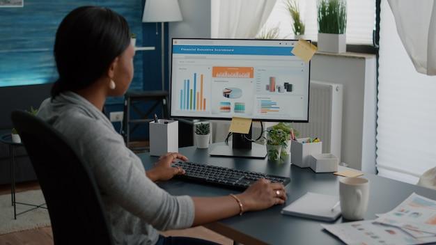 High school black student typing financial information analyzing digital statistics