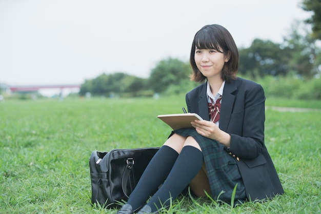 High school girl reading and studying