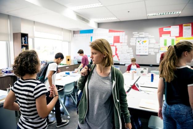 High school students leaving classroom