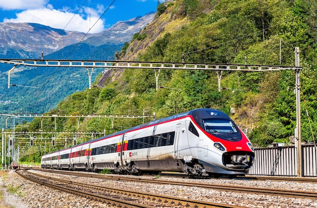 High speed train on the gotthard railway in the swiss alps