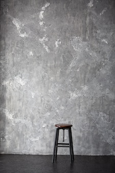 High stool on a gray background wiht copy space for text