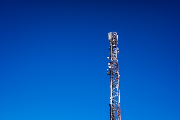High telecommunications tower, with antennas for mobile phones creating radio cells