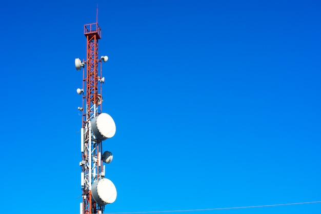 High telephone tower. beautiful sky with a communications tower in the foreground