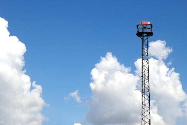 High tower emergency spot light for train signal on clear sky