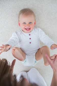 High view of a baby lying on back