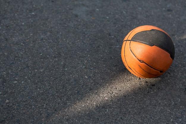 High view basketball on asphalt
