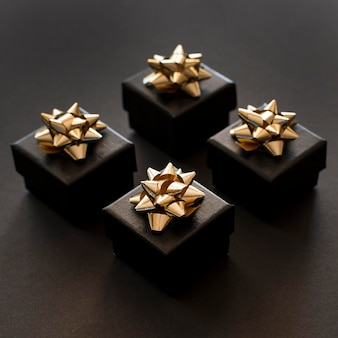 High view black gift boxes with golden ribbons