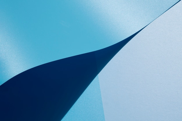 High view of blue curved sheets of paper