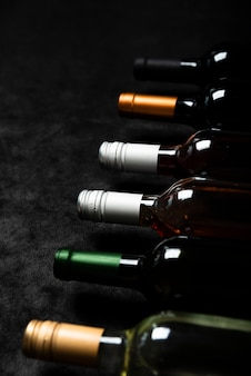 High view bottles of wine with black background