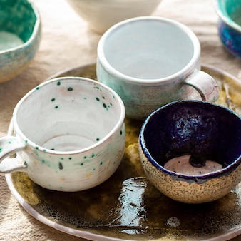 High view bowls and mugs pottery concept