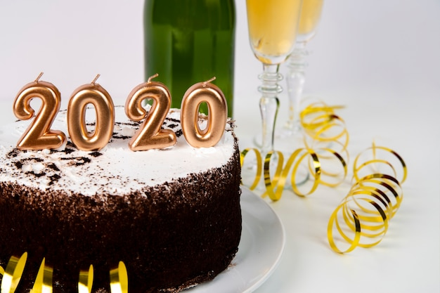 High view cake and drink 2020 new year digits