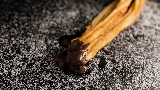 High view churros dipped in chocolate