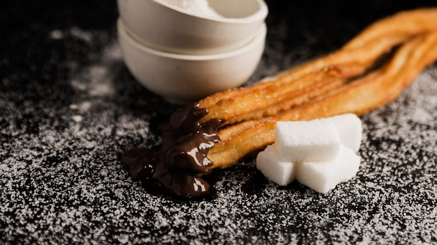 High view churros and sugar cubes