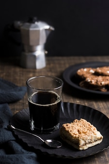 High view cold coffee with cookies and blurred grinder