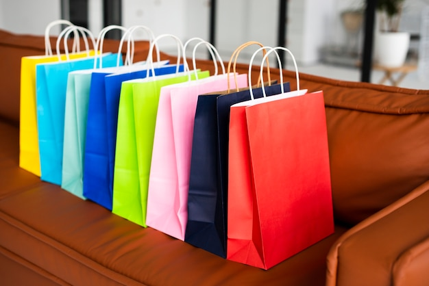 High view of colourful paper bags on couch