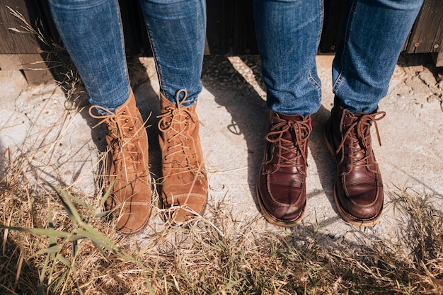 High view couple in jeans and boots
