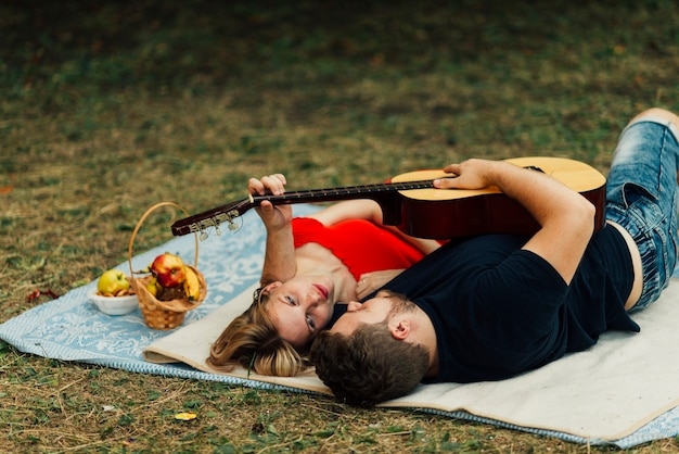 High view couple playing on classical guitar